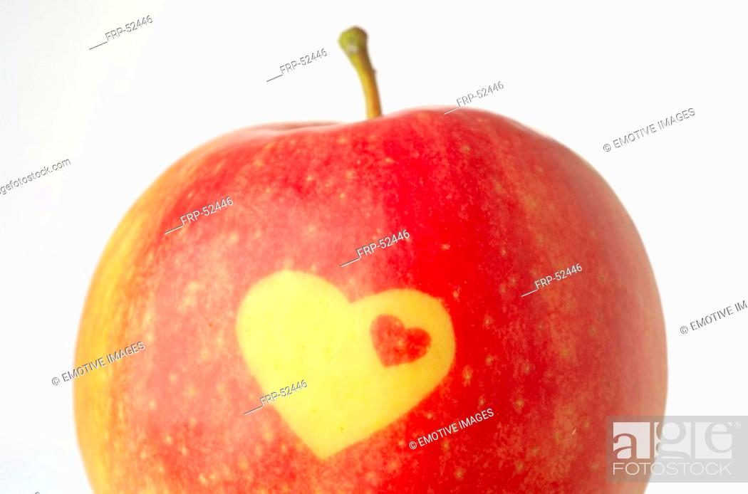 Stock Photo: Apple with decorative heat form.