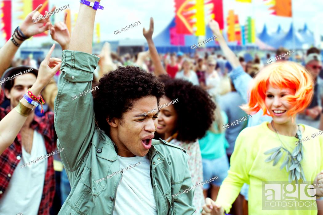 Stock Photo: Friends dancing and cheering at music festival.