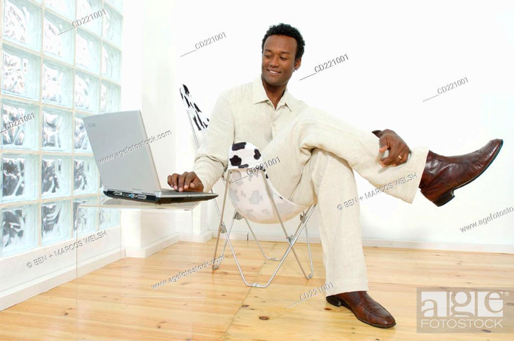 Stock Photo: Black business man, working, computer.