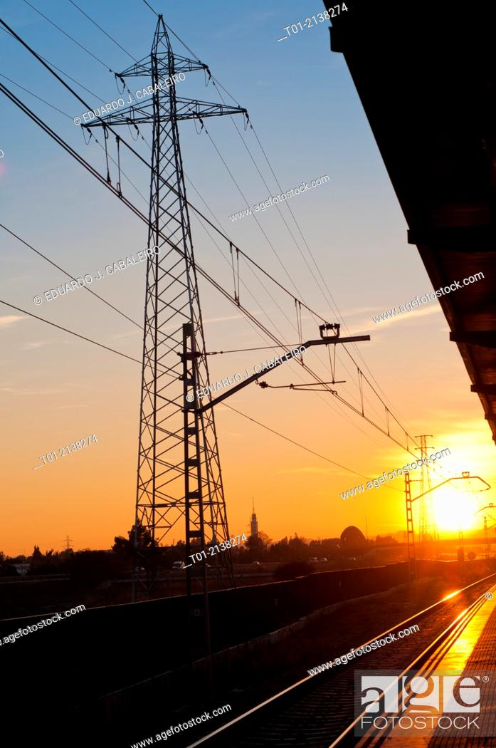 Stock Photo: electrical tower next to the railway station at sunset in San Jeronimo in Seville.