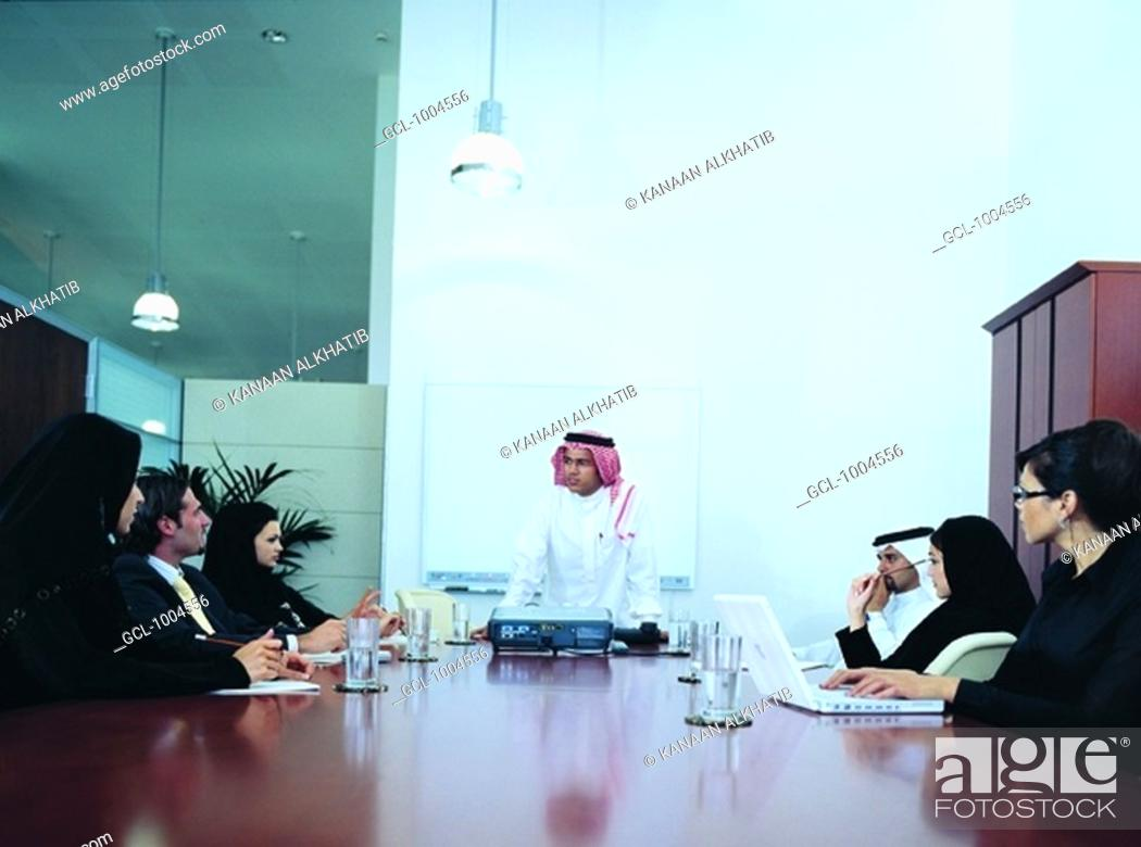 Stock Photo: Meeting of Arab businesspeople in boardroom.