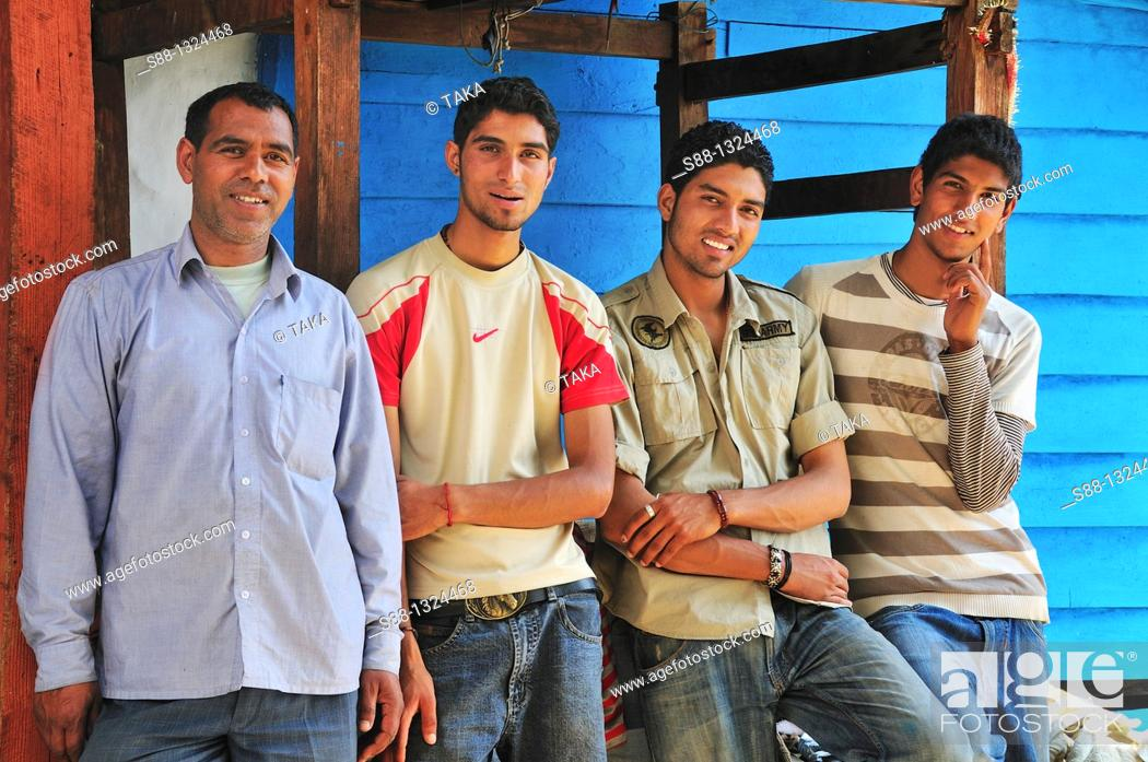 Stock Photo: Father and three sons. Manali, Himachal Pradesh, India.