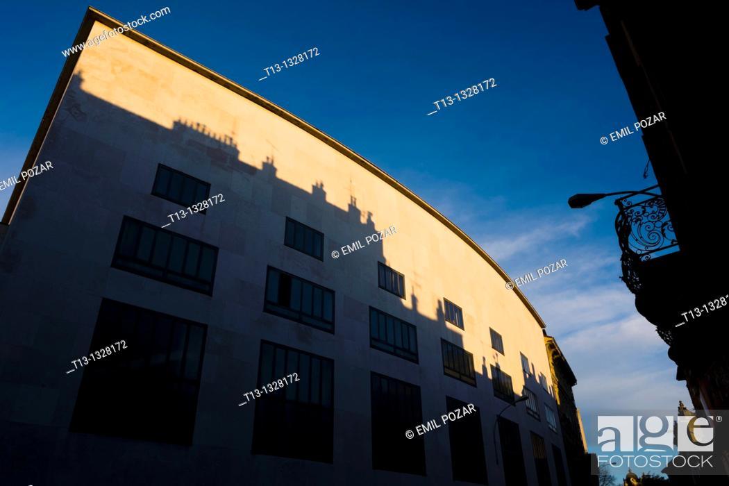 Stock Photo: Rijeka in Croatia, theatre 'HKD Susak' curved-roof building in a sunset time.