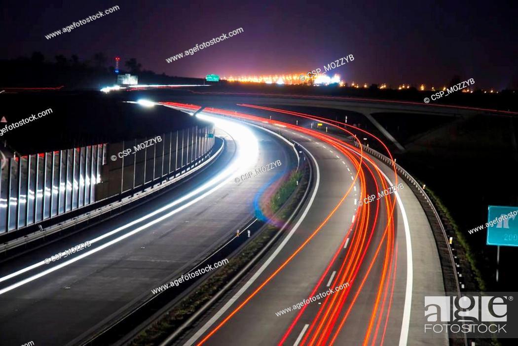 Stock Photo: Night highway - long exposure - light lines.