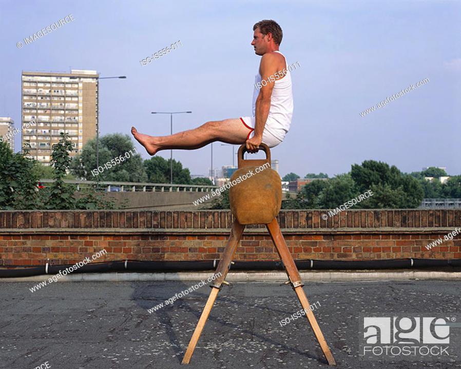 Stock Photo: Gymnast on roof.