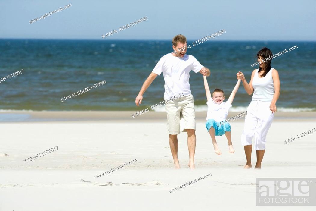 Stock Photo: family walking on beach.