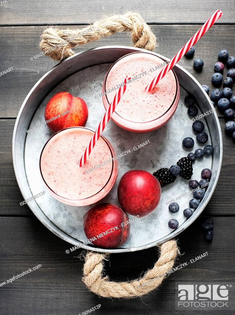 Stock Photo: Fresh fruit smoothies with nectarines and blackberries.