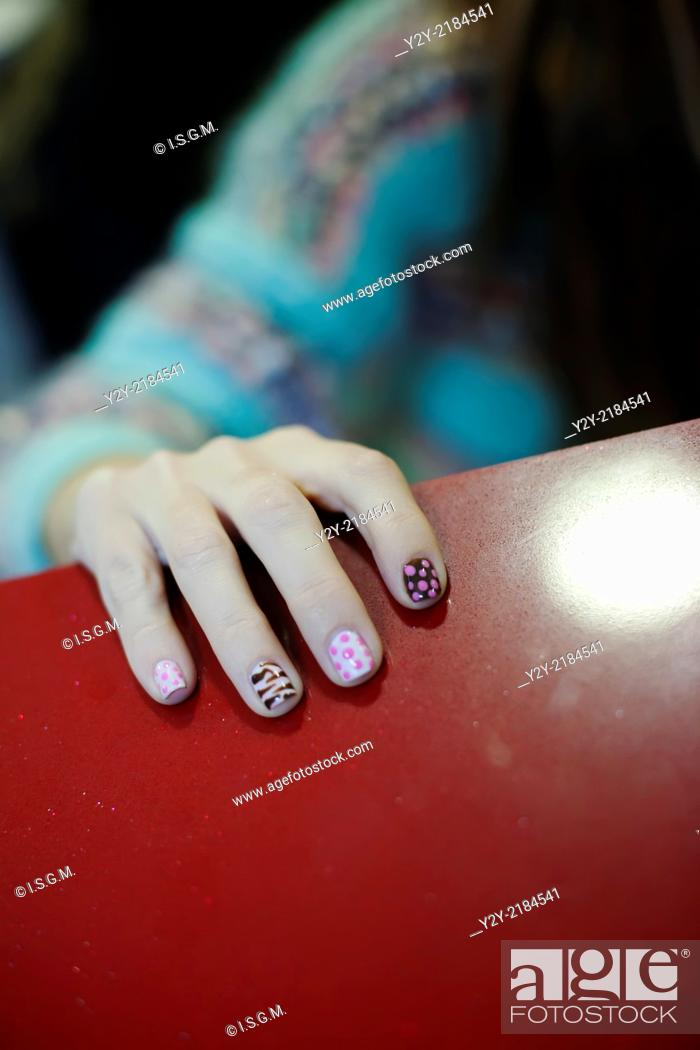 Stock Photo: Girl with decorated nails.