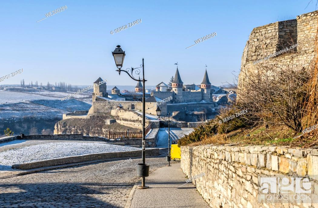 Stock Photo: Kamianets-Podilskyi, Ukraine. City gate of the Kamianets-Podilskyi old town on a sunny winter morning.