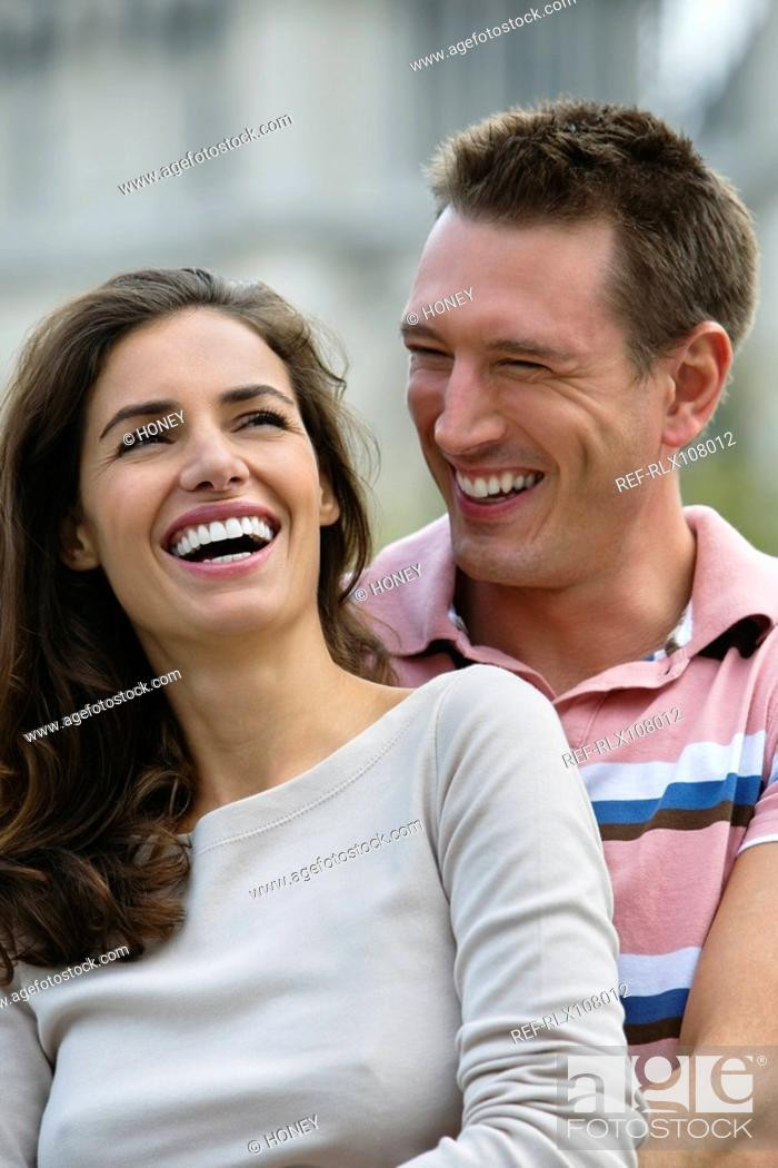 Stock Photo: Young couple laughing and embracing, Paris, France.