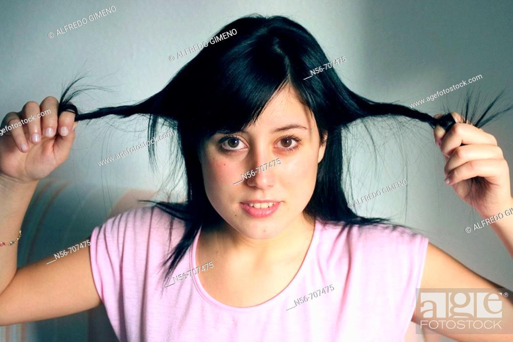 Stock Photo: Girl Pulling her hair.
