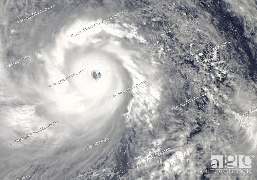 Stock Photo: PACIFIC OCEAN Philippines -- 07 Nov 2013 -- This NASA MODIS Aqua satellite image shows what is possibly the strongest storm ever - Super Typhoon Haiyan -.