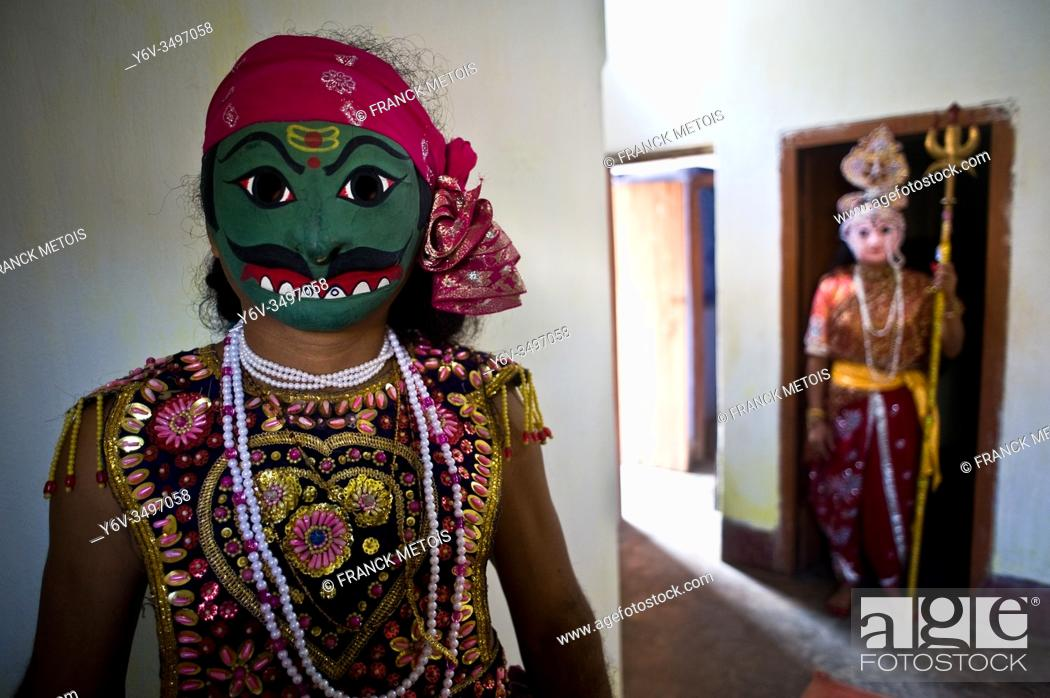 Stock Photo: Seraikela Chhau dancers ( Jharkhand, India). He is playing the role of a ''rakshasa'' ( demon). In the background, another dancer is playing the role of the.