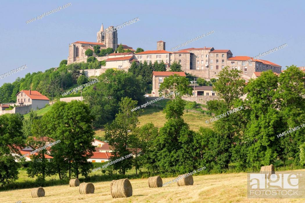 Stock Photo: France, Loire, Forez region, Saint Bonnet le Chateau, the 17th century Forez Gothic style Collegiate church in the heart of historic quarter.