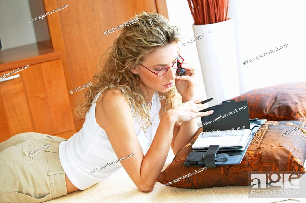 Stock Photo: woman at home with telephone.
