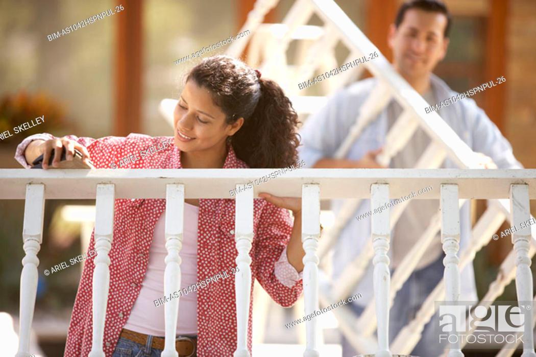Stock Photo: Couple fixing railing.