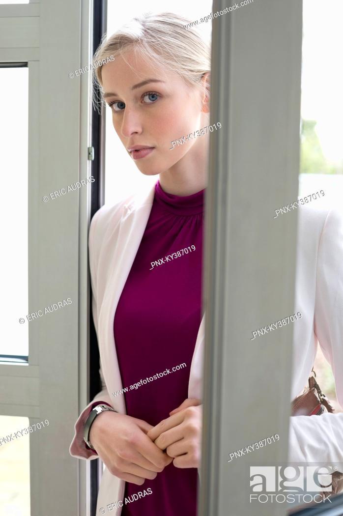 Stock Photo: Businesswoman entering home.