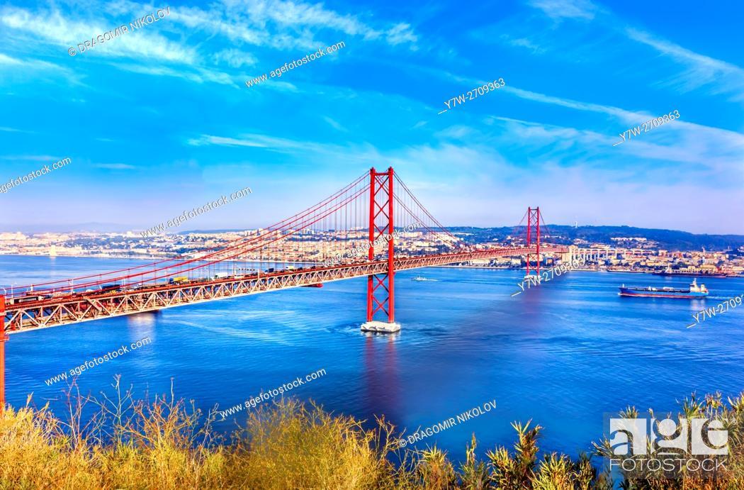 Stock Photo: Bridge of 25th April over river Tajo, Lisbon, Portugal.