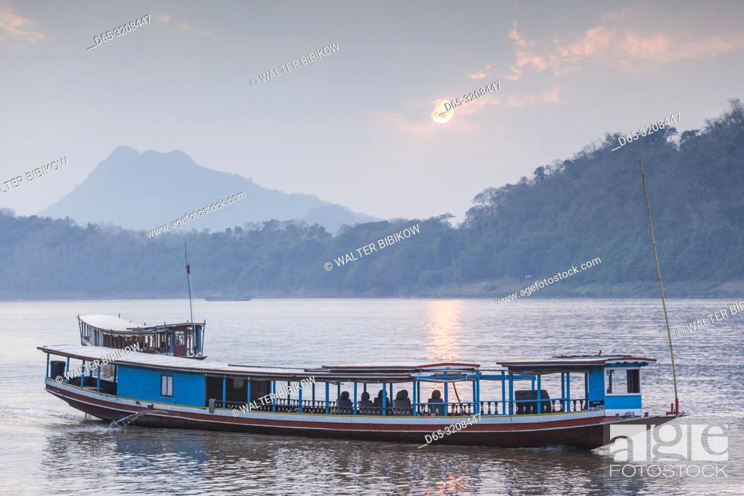 Stock Photo: Laos, Luang Prabang, Riverboats on the Mekong River, sunset.