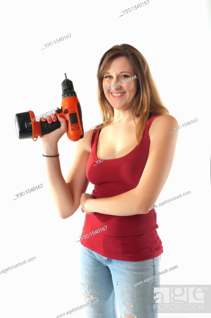 Stock Photo: Woman with cordless screwdriver.