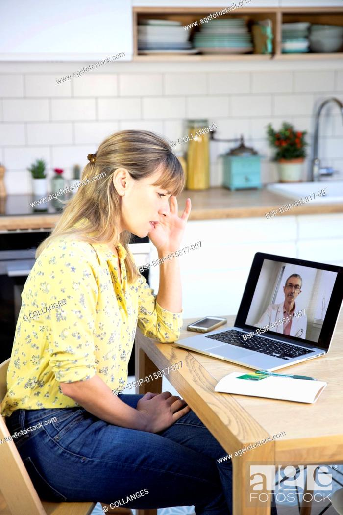 Stock Photo: A video consultation between a young woman and her GP.