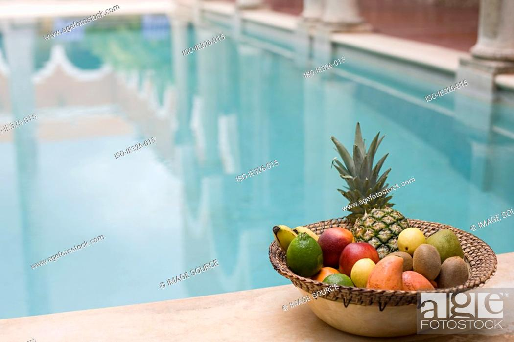 Stock Photo: Fruit by swimming pool.