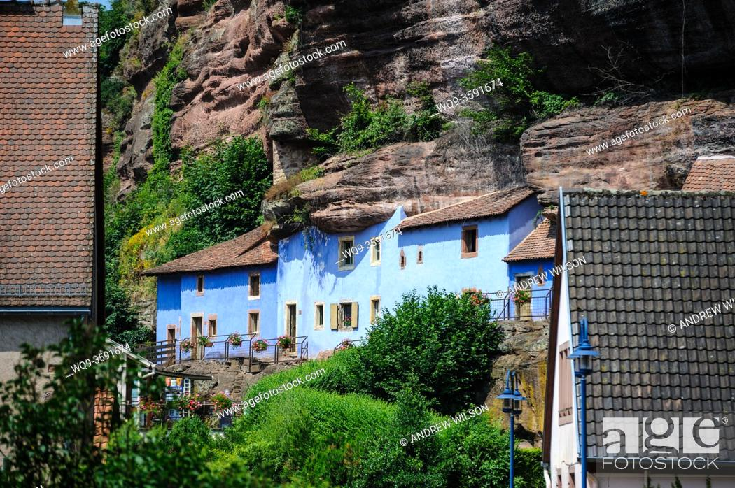 Stock Photo: New and very old dwellings in the village of Graufthal, Alsace, France. The troglodyte houses are built into the cliffs with the rock forming the ceiling and.