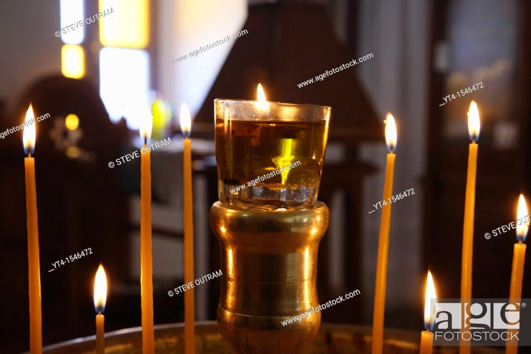 Stock Photo: Candles inside a Greek Orthodox Church, Crete, Greece.