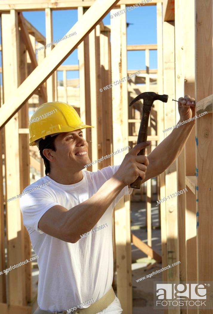 Stock Photo: Construction Worker Building a House.
