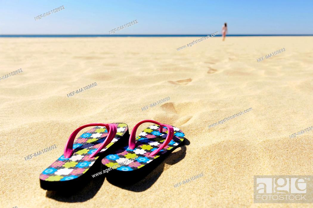 38820820e Stock Photo - Flip flops on beach