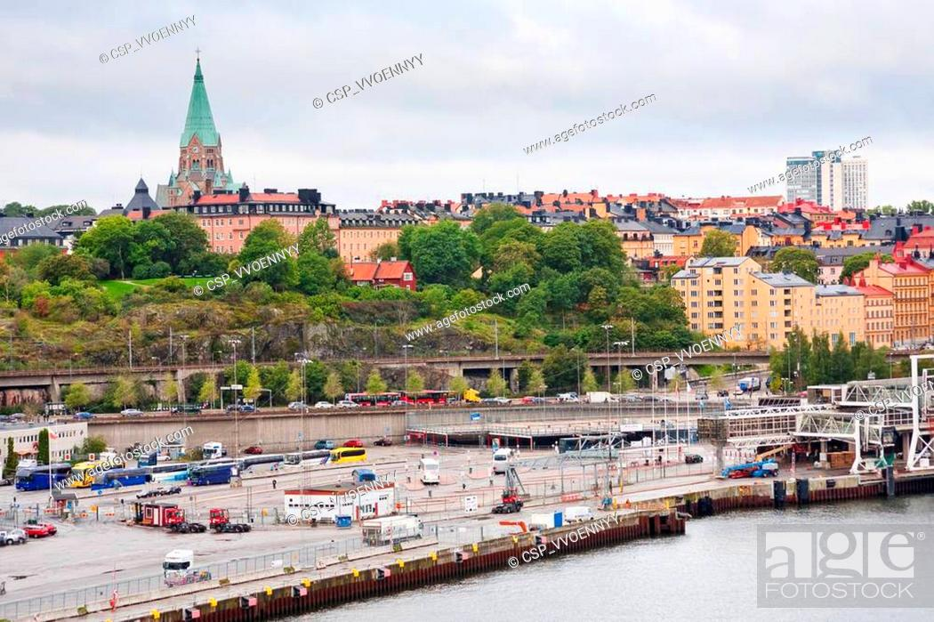 Stock Photo: view on shipping terminal and old Sofia Church in Stockholm.