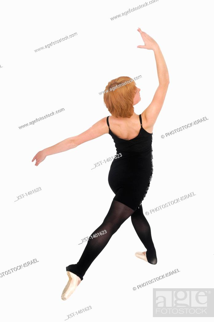 Stock Photo: Female Ballet Dancer balances on her tows On white Background.