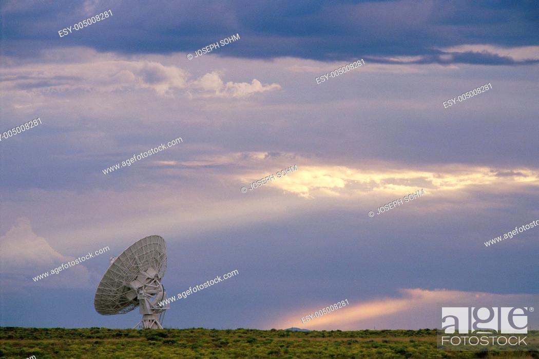 Stock Photo: VLA Very Large Array radio telescope dish alone in field.