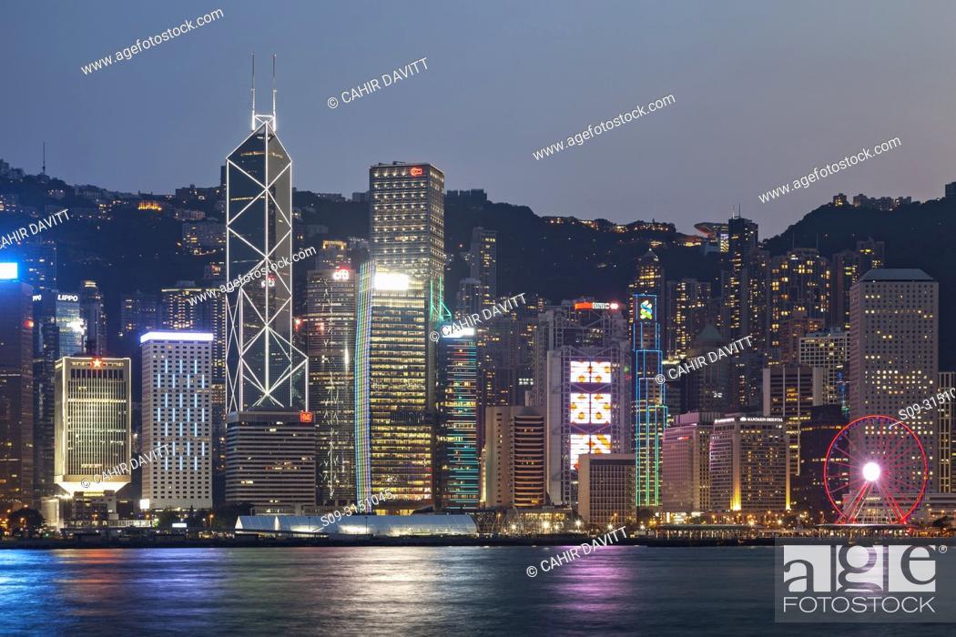 Stock Photo: Skyscrapers on Hong Kong Island skyline with the Bank of China and Hong Kong Shanghai Bank at twilight seen from Tsim Sha Tsui, Kowloon, Hong Kong, S.