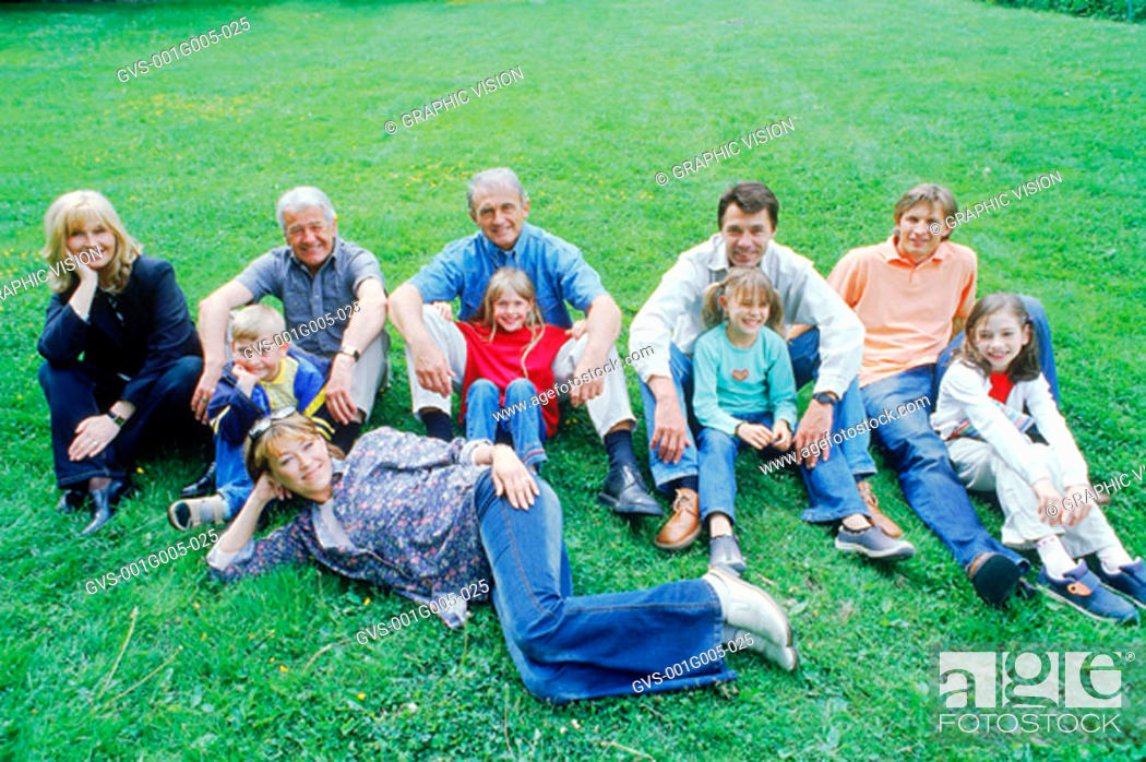 Stock Photo: Portrait of a family sitting on a lawn.