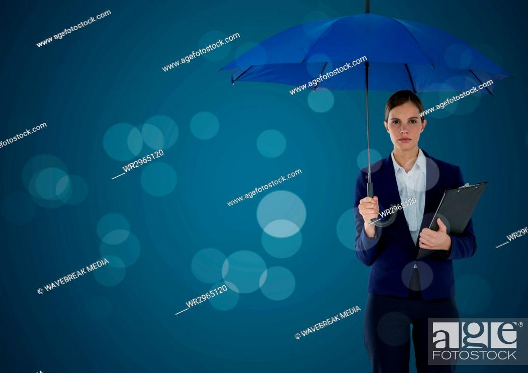 Imagen: Business woman with umbrella and clipboard against blue background and bokeh.