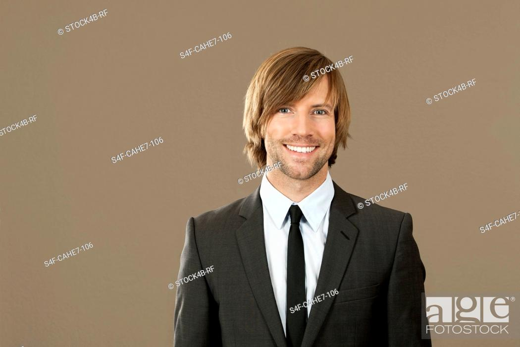 Stock Photo: Smiling businessman wearing suit.