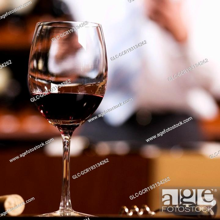 Imagen: Wine glass and a corkscrew in a bar.