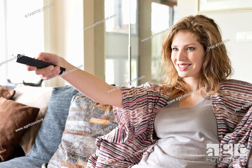 Stock Photo: Woman watching television in a living room.