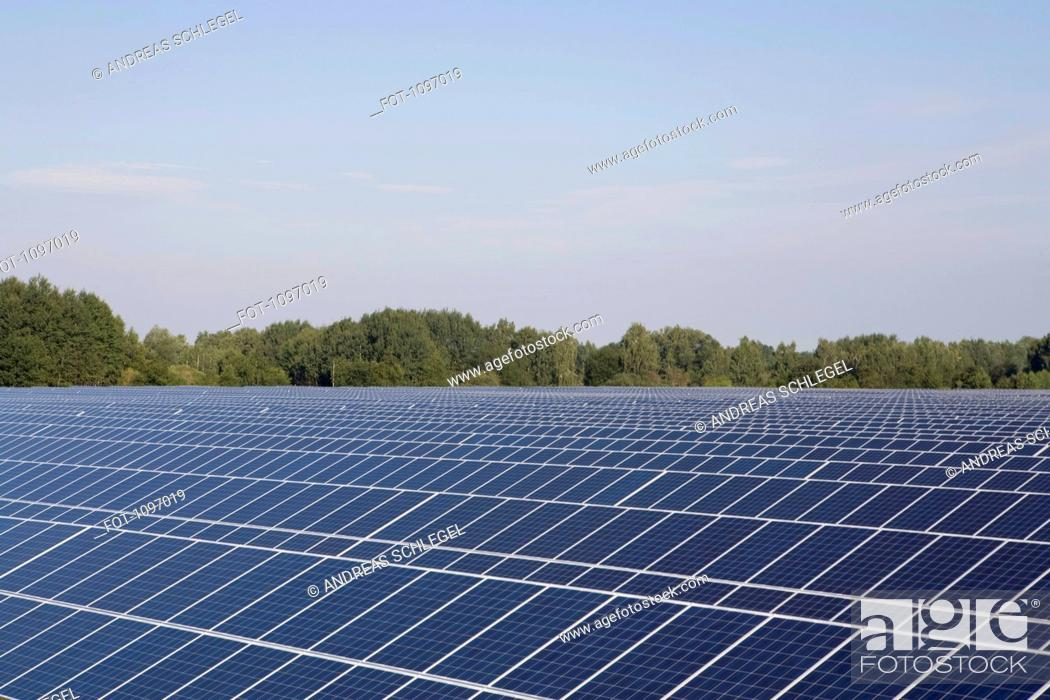 Stock Photo: Rows of solar panels in a field.