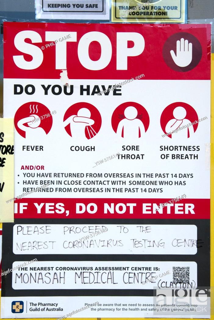 Stock Photo: COVID-19 health warning to pharmacy customers, Mellbourne, Victoria, Australia.