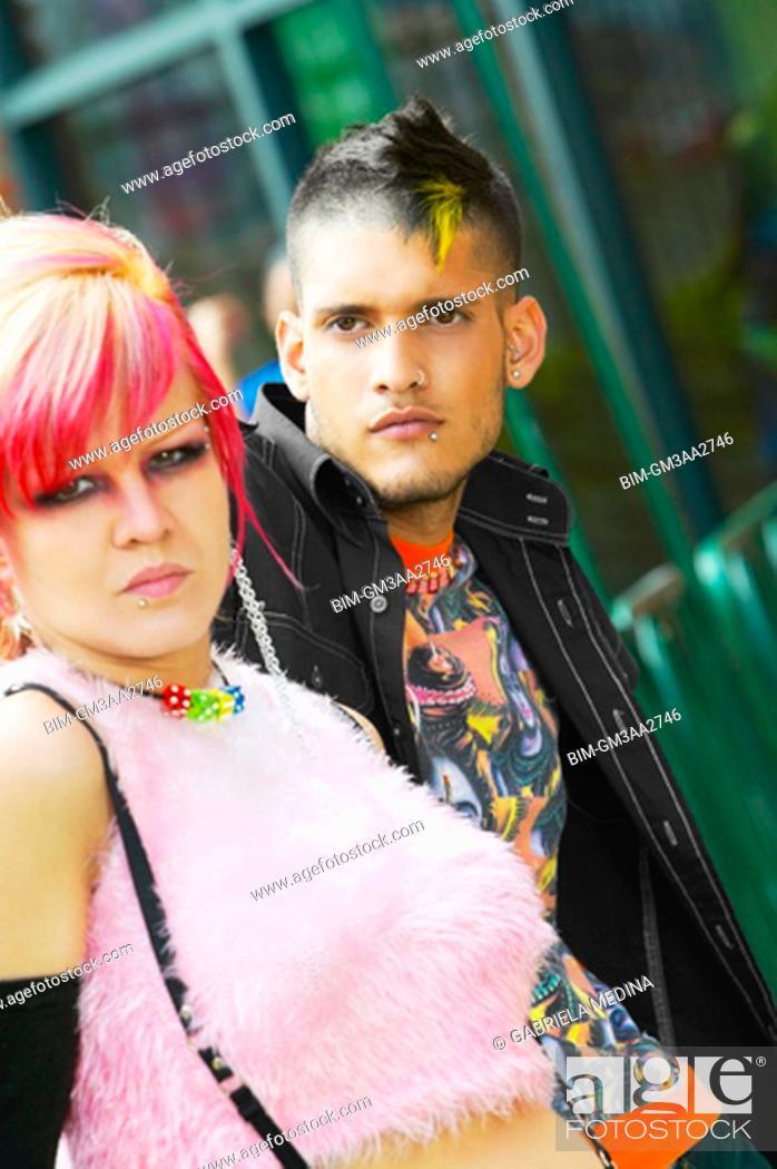 Stock Photo: Close up of Hispanic punk couple outdoors.