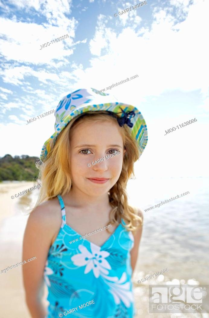 Stock Photo: Girl standing on beach portrait.