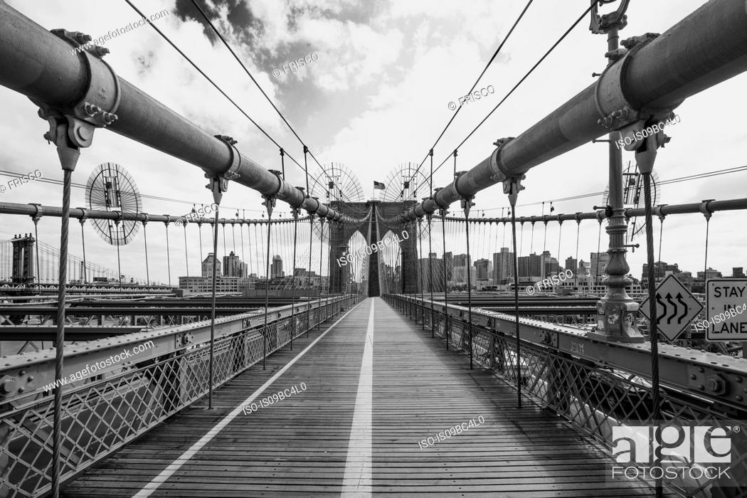 Stock Photo: View of Brooklyn Bridge walkway, B&W, New York, USA.