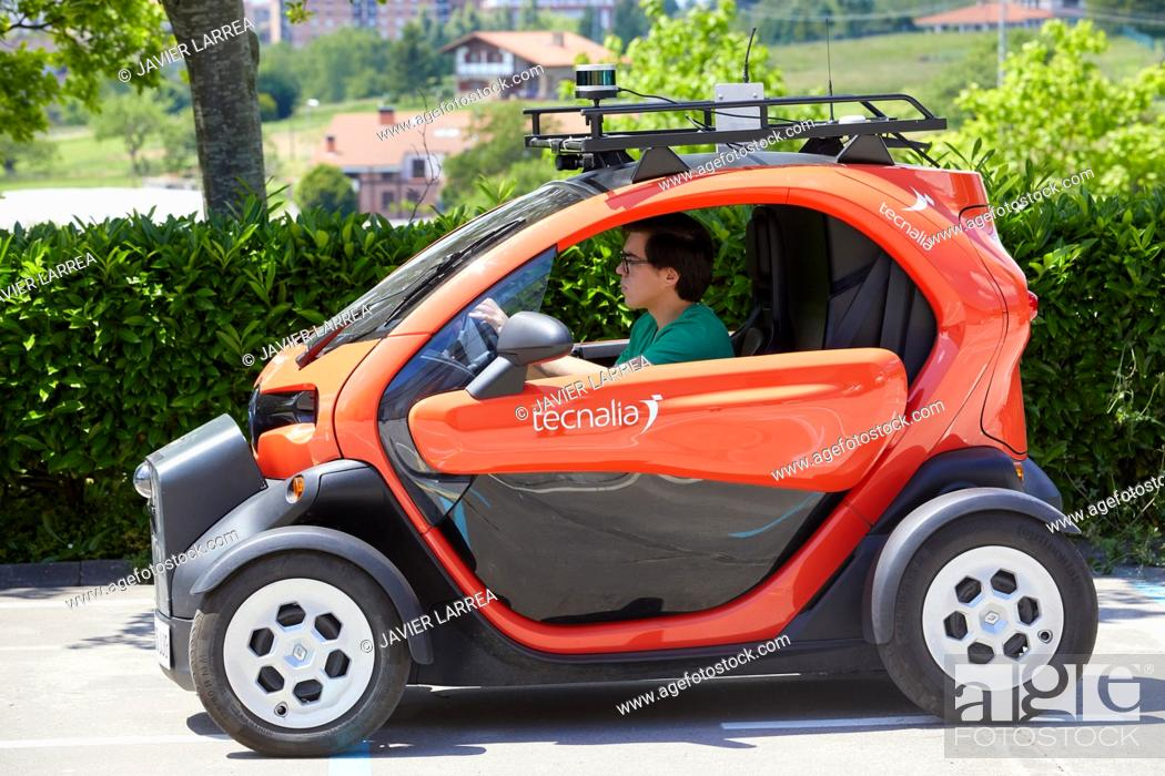 Stock Photo: Twizzy, electric vehicle, Researchers work in two electric cars, the first one piloted manually and the second one will follow it completely autonomously taking.