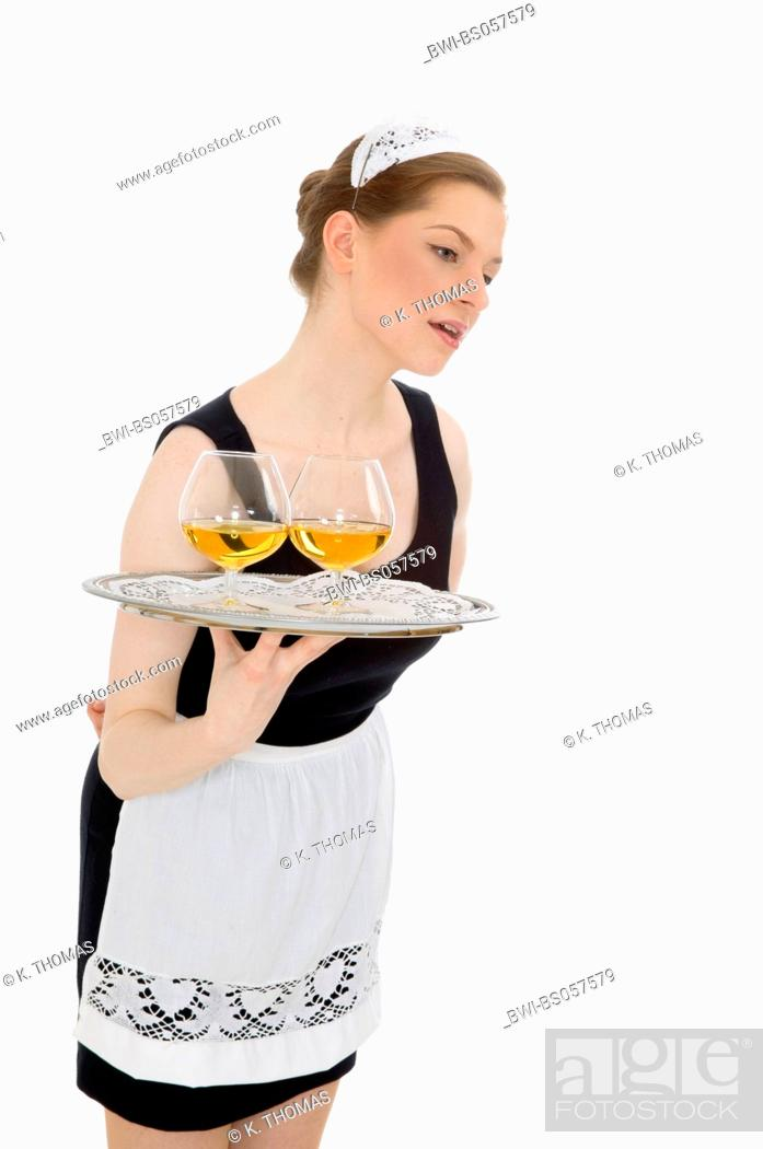 Stock Photo: young woman in white apron and black dress holding a tray, waitress.