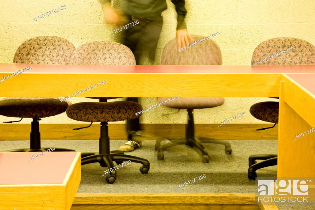 Stock Photo: Man sitting in a college classroom.