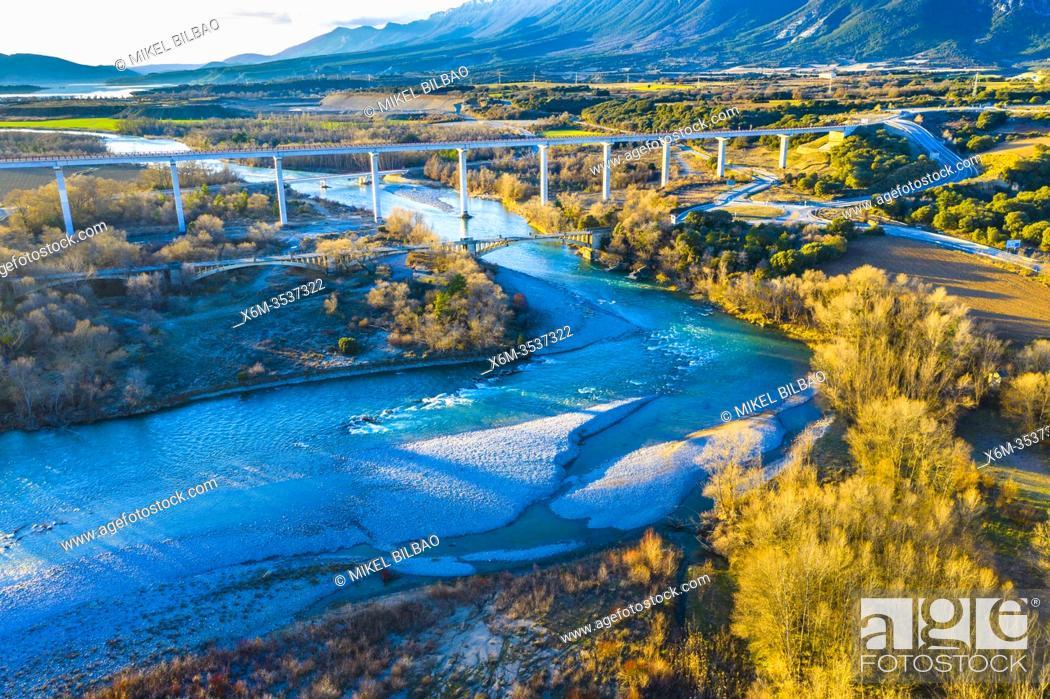Stock Photo: Riverbed and bridge in a natural landscape. Aragon river close to Yesa reservoir. Zaragoza, Aragon, Spain, Europe.