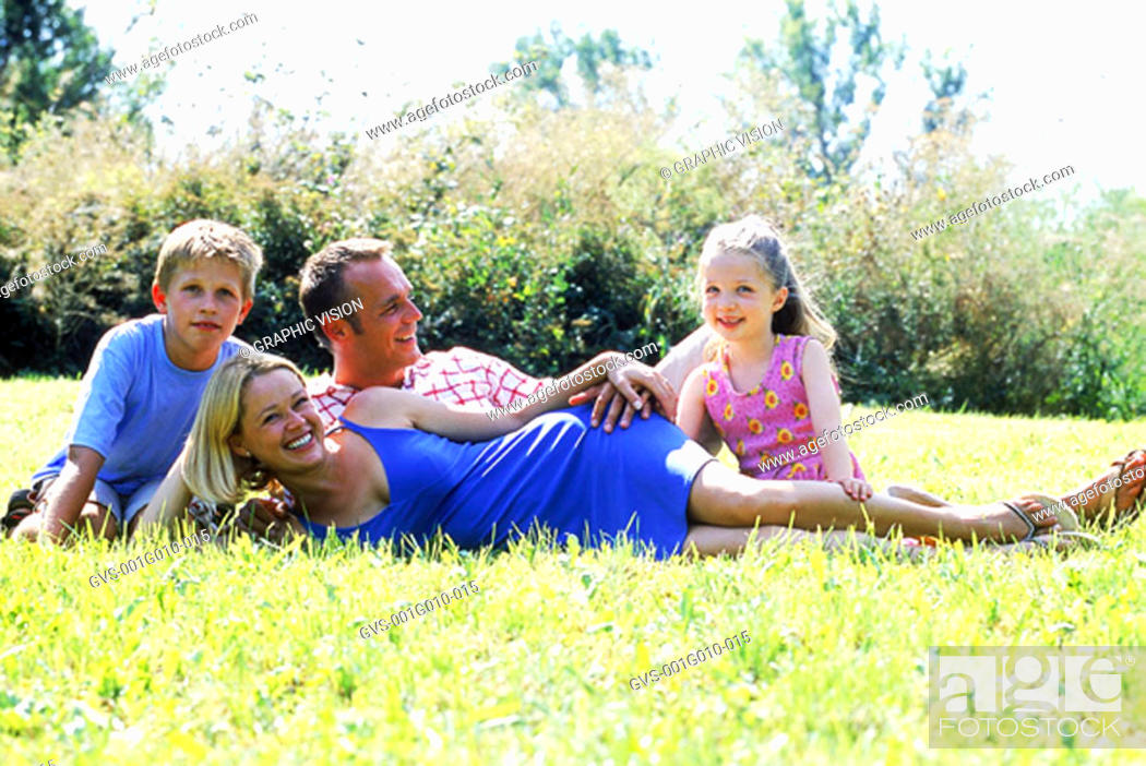 Stock Photo: Portrait of parents with children in park.