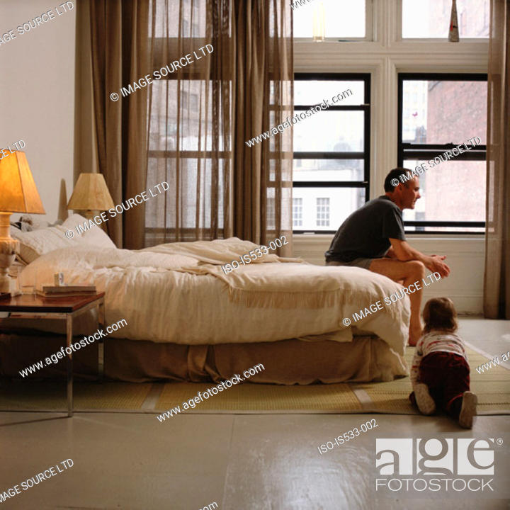 Stock Photo: Father and daughter in bedroom.